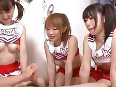 Asians cheerleaders sharing and sucking one cock