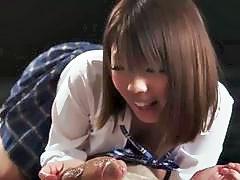 18 year old Japanese schoolgirl Rion Karina gives a tender handjob