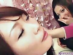 2 Asian Girls Kissing Spitting Sucking Tongues On The Couch